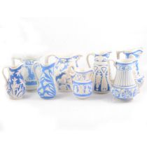 Eight Victorian relief-moulded jugs, various makers.
