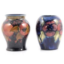 Moorcroft Pottery 'Pomegranate' and 'Pansy' vases.