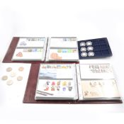 Collection of modern commemorative coins and first day covers.