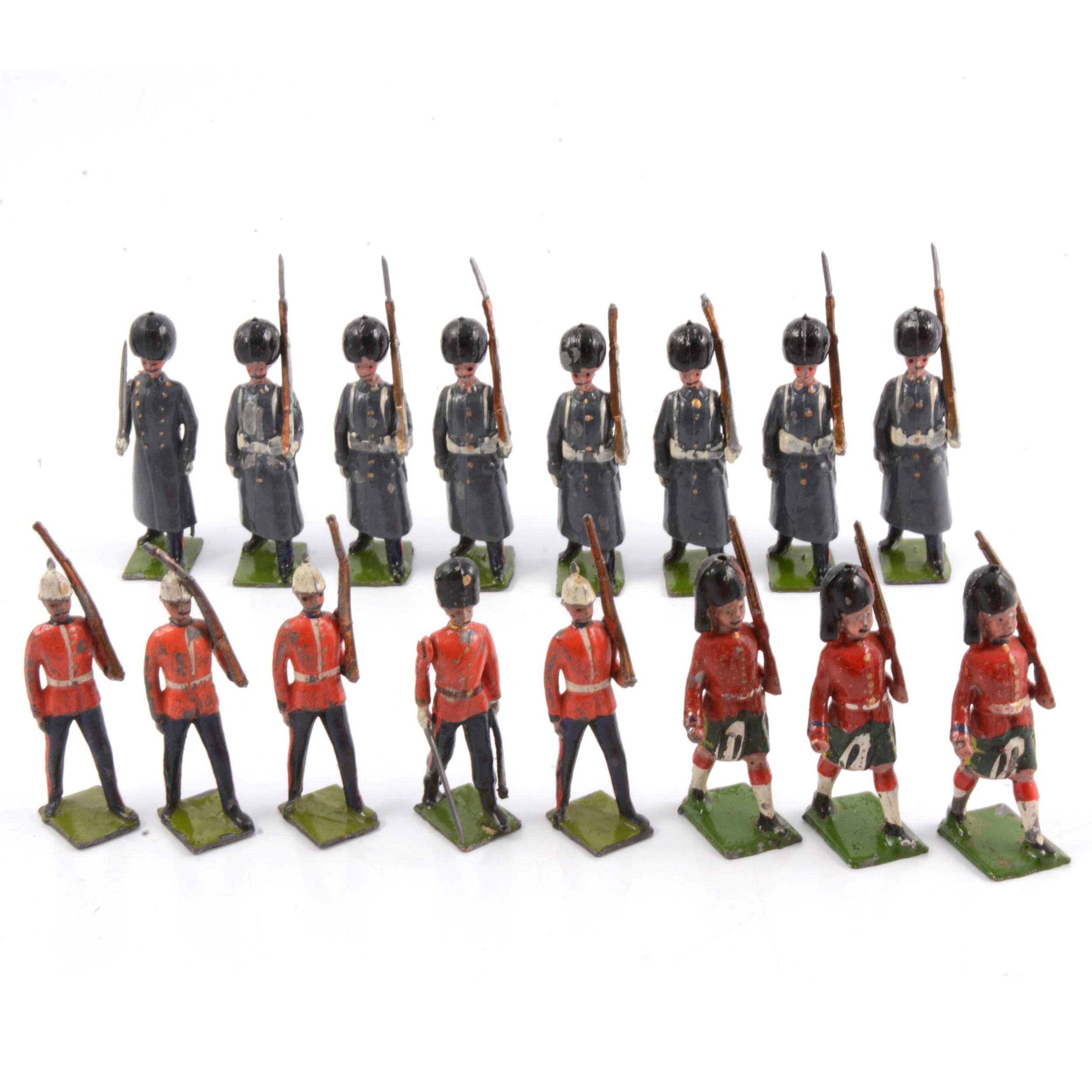 Britains lead-painted figures, including eight Grenadier Guards in greatcoats