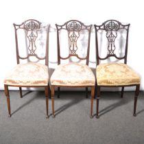 Three Edwardian stained walnut side chairs