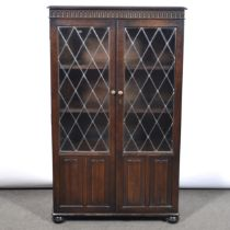 Two stained oak glazed bookcases and an open bookcase