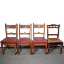 Three late Victorian oak dining chairs, and another
