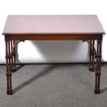 Reproduction mahogany coffee table in the style of a silver table