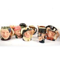 Eleven Royal Doulton character jugs,