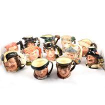 Twelve Royal Doulton character jugs.
