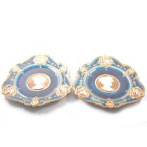 Pair of Geman wall plates, cameo centre surrounded by vignettes.