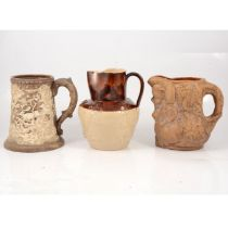 Continental pottery hunting tankard and two stoneware jugs,