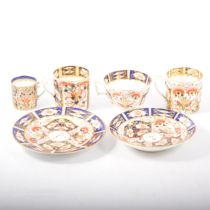 Royal Crown Derby, Imari pattern trio and three coffee cans