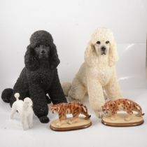 Two large resin poodles, other poodle models and ornaments,