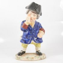 A 19th century snuff taking standing man toby jug with hat.