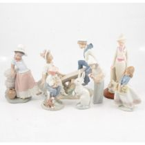 Six Lladro porcelain figures and a Spanish figure of an Edwardian lady
