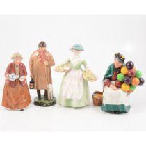 Four Royal Doulton figurines.
