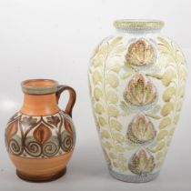A Glyn Colledge design ovoid vase for Denby, green leaf pattern, and a pitcher.