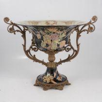 A pedestal bowl with metal mounts and a Doulton stoneware pedestal base.