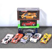 Eight 1:18 scale model racing cars; including Universal Hobbies Porsche 917