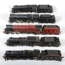 Five OO gauge model railway locomotives and a spare tender.