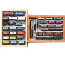 Fourty-three OO gauge model railway wagons and advertising vans