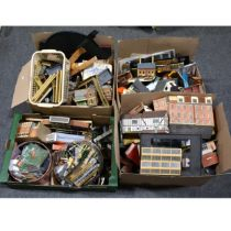 Four boxes of mostly OO gauge track-side accessories, buildings, scenery and parts.