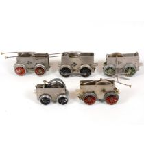 Six Hornby O gauge model railway clock-work motor chassis for locomotives, all loose.