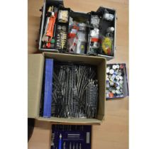 A case of model railway accessories, parts, paints and spares