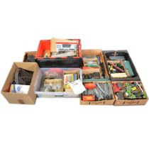 A large quantity of OO and HO gauge model railway, seven boxes.