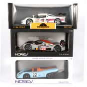 Three 1:18 scale models racing cars; including Norev Porsche 917K