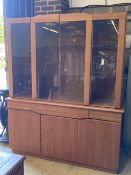 Skovby, Denmark, a teak cabinet fitted plate glass doors over three drawers and three cupboards,