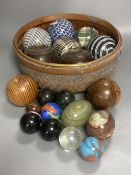 A collection of Scottish ceramic and other carpet bowls