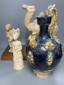 A group of Chinese Tang style pottery figures, tallest 28cm and a partially glazed ewer in sancai