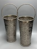 A pair of silver plated embossed champagne buckets, 48cm high including handle
