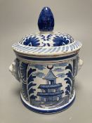 An 18th/19th century Delft blue and white jar and cover, with bearded mask handles, 17cm