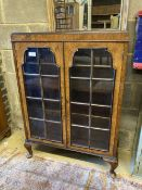 A 1920s Queen Anne revival bookcase, width 78cm, depth 26cm, height 108cm