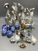 A collection of Lladro and Goebel porcelain figures and other items