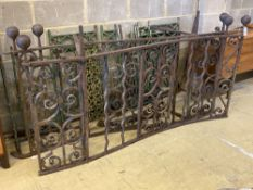 A cast and wrought iron two section balcony railings, total length approx. 385cm and assorted iron