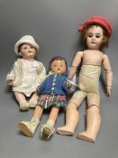 An Armand Marseille bisque boy doll, mould 990 with fixed glass eyes, 30cm, a bisque doll with
