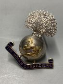 A paste and enamel set yellow and white metal 'The Indian Grenadiers' brooch, 44mm.