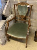 An Edwardian bone and marquetry-inlaid rosewood elbow chair, on square tapered legs with castors,