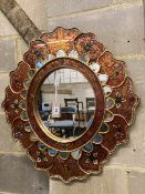 An Indian oval painted wall mirror, width 63cm, height 69cm