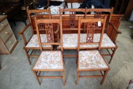 An Edwardian inlaid mahogany four piece part salon suite