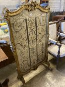A 19th century Louis XV style giltwood fire screen having embroidered silk panel, width 85cm, height