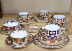 A collection of six Royal Crown Derby cups and saucers, a small square trinket dish and a