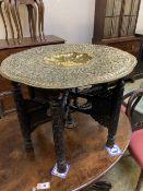 A Benares brass tray top table, 78cm diameter, 62cm high