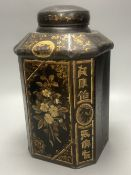A 19th century toleware octagonal tea canister, J. Newman, Dublin, painted with flowers and
