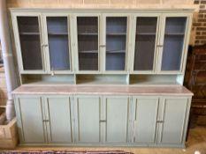 A Victorian style painted twelve door cabinet, width 304cm, depth 60cm, height 240cm