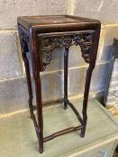 A Chinese carved hardwood square topped stand, width 23cm, height 56cm