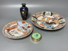 Two Japanese plates, a cloisonne vase and a seal paste box, largest 24.5cm