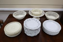 A collection of white glazed basket weave and other dessert ware