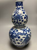 A large Chinese double gourd vase, blue and white dragon design, height 38cm
