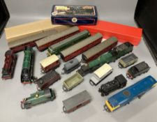 A collection of 00 gauge locomotives, wagons and coaches to include Hornby and Triang